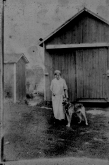 <h5>Unknown woman and dog</h5>