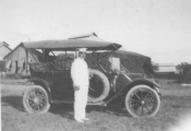 <h5>C.C. Ballou with car in the Phillipines</h5>